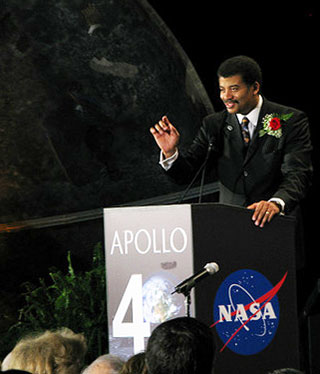 A photo of Neil deGrasse Tyson speaking at the National Air and Space Museum.
