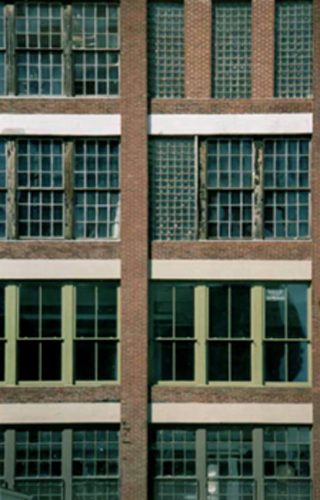A photograph of windows in Philadelphia, representing a block matrix.